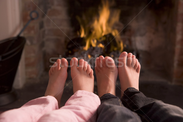 Pies chimenea ninos fuego feliz nino Foto stock © monkey_business