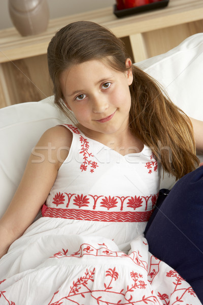 Young Girl Sat on Sofa at Home Stock photo © monkey_business