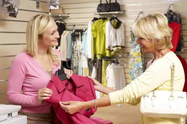 продажи помощник клиентов одежду магазине женщину Сток-фото © monkey_business