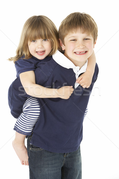 Studio Portrait Of Brother Giving Sister Piggy Back Stock photo © monkey_business