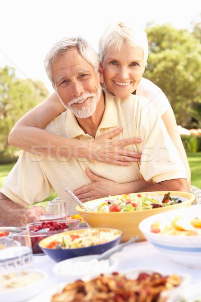 Stockfoto: Genieten · maaltijd · tuin · vrouw · gelukkig