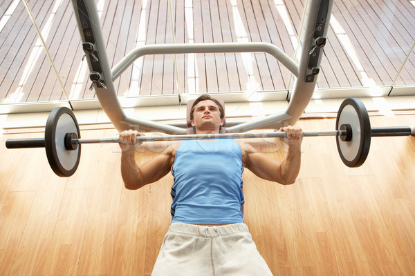 Man Working With Weights In Gym Stock photo © monkey_business