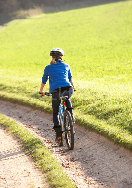 Young woman rides her bike in park Stock photo © monkey_business