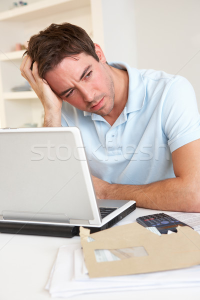 Young man working with laptop computer Stock photo © monkey_business