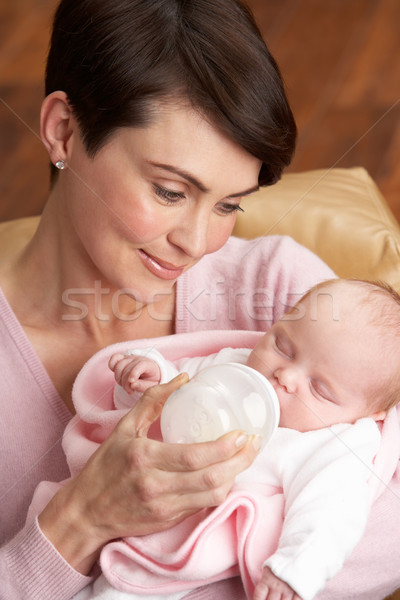 Portrait Of Mother Feeding Newborn Baby At Home Stock photo © monkey_business