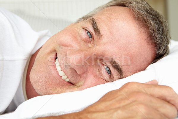 Head and shoulders mid age man lying down Stock photo © monkey_business