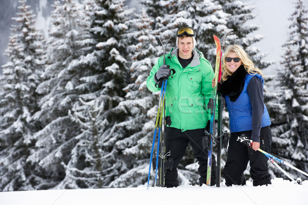 Young Couple On Ski Holiday In Mountains Stock photo © monkey_business