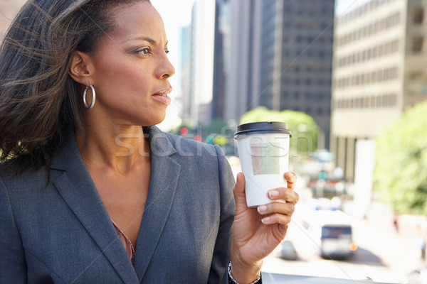 Businesswoman Drinking Takeaway Coffee Outside Office Stock photo © monkey_business