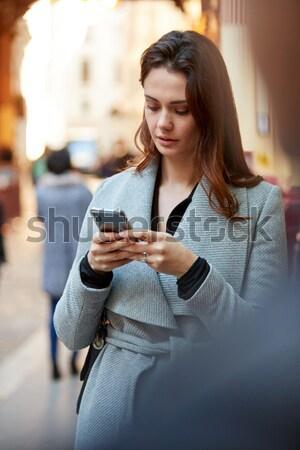 Nő küldés szöveges üzenet kávézó nők boldog Stock fotó © monkey_business