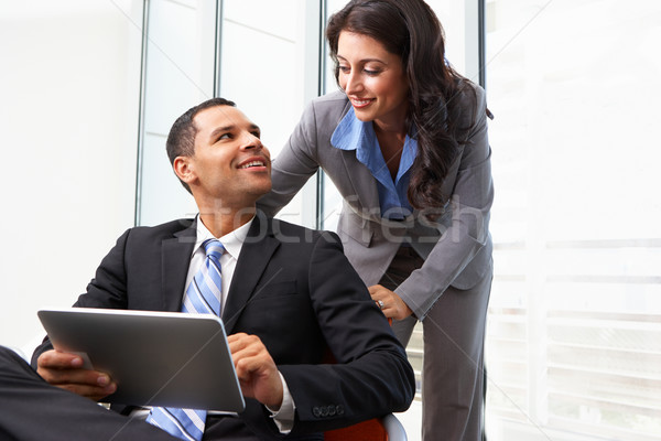 Businesspeople With Digital Tablet During Informal Meeting Stock photo © monkey_business