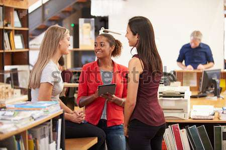 Portrait Of Female Pupil Studying At Desk In Classroom Stock photo © monkey_business