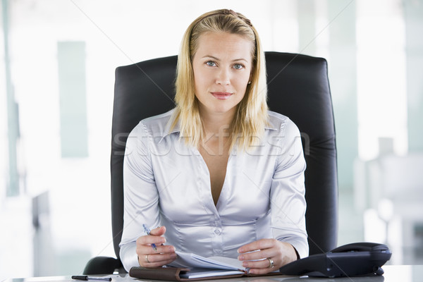 Businesswoman sitting in office with personal organizer Stock photo © monkey_business