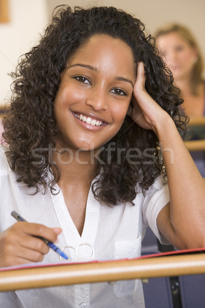 Female college student listening to a university lecture Stock photo © monkey_business