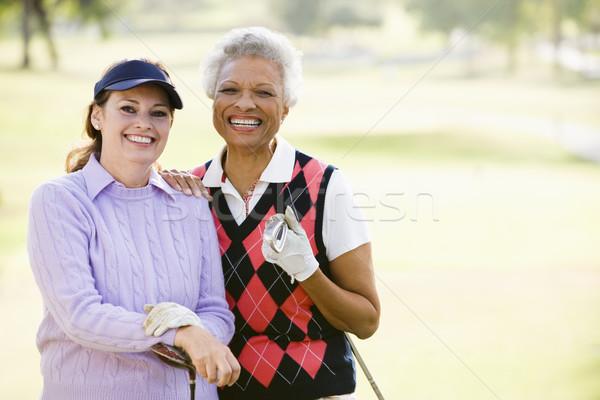 Female Friends Enjoying A Game Of Golf Stock photo © monkey_business