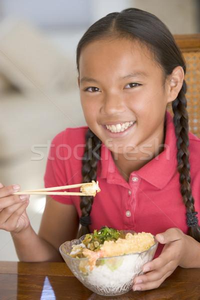 Młoda dziewczyna jadalnia jedzenie Chinese Food uśmiechnięty dziewczyna Zdjęcia stock © monkey_business