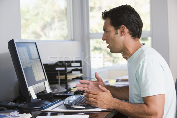 Man in home office using computer looking frustrated Stock photo © monkey_business