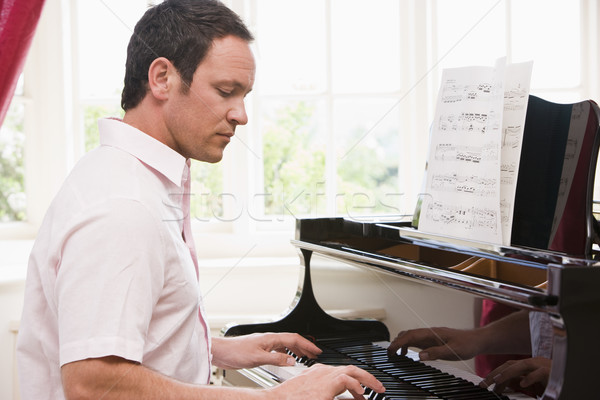 Stock photo: Man playing piano