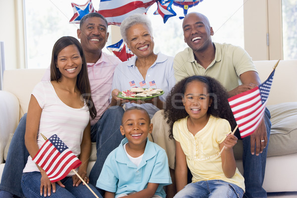 Family in living room on fourth of July with flags and cookies s Stock photo © monkey_business