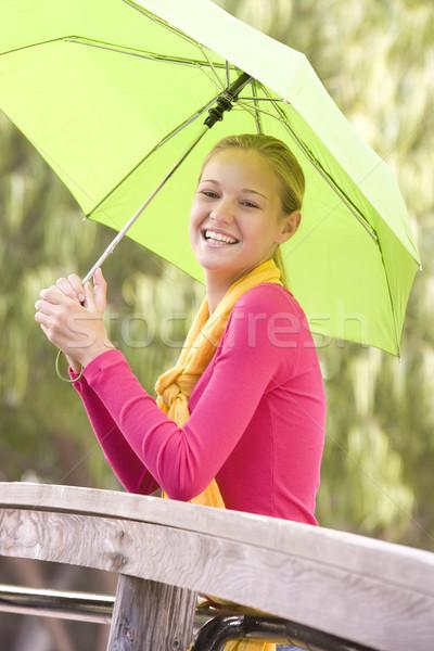 Retrato ao ar livre adolescente guarda-chuva sorridente Foto stock © monkey_business