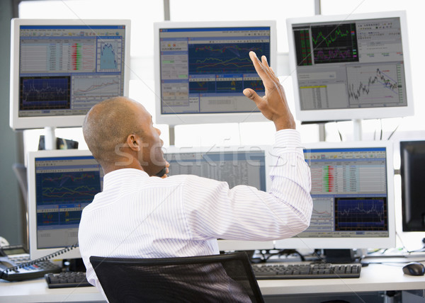 Stock Trader Talking Animatedly On The Phone Stock photo © monkey_business