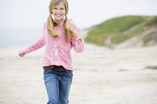 Young girl running at beach smiling Stock photo © monkey_business