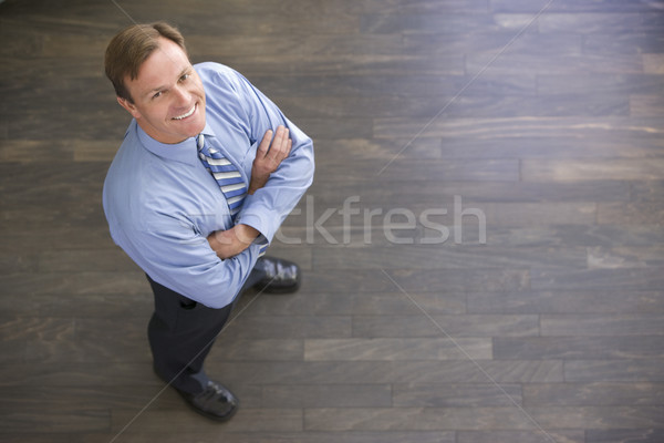 Businessman standing indoors smiling Stock photo © monkey_business