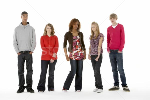 Full Length Studio Portrait Of Five Teenage Friends Stock photo © monkey_business