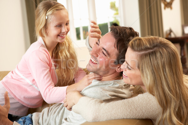 Happy young family playing together on sofa Stock photo © monkey_business