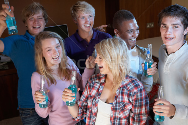 Group Of Teenage Friends Dancing And Drinking Alcohol Stock photo © monkey_business