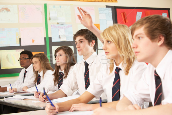 Teenage Student Answering Question Studying In Classroom Stock photo © monkey_business