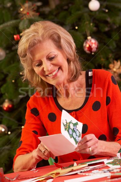 Senior mulher natal cartões casa Foto stock © monkey_business