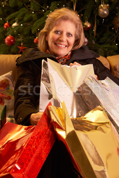 Senior Woman Returning After Christmas Shopping Trip Stock photo © monkey_business
