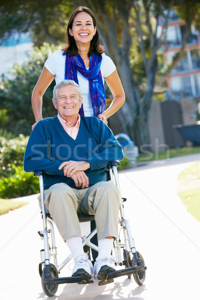 Adult Daughter Pushing Senior Father In Wheelchair Stock photo © monkey_business