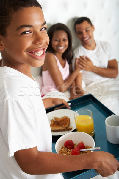 Son Bringing Parents Breakfast In Bed Stock photo © monkey_business