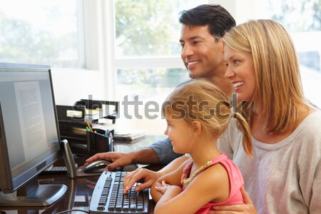Teacher Helping Students Working At Computers In Classroom Stock photo © monkey_business