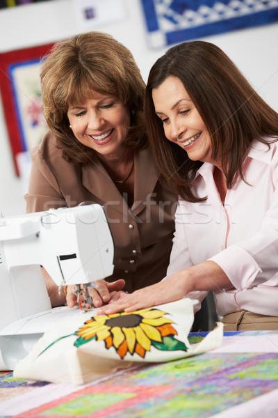 две женщины электрических швейные машины женщины счастливым дизайна Сток-фото © monkey_business