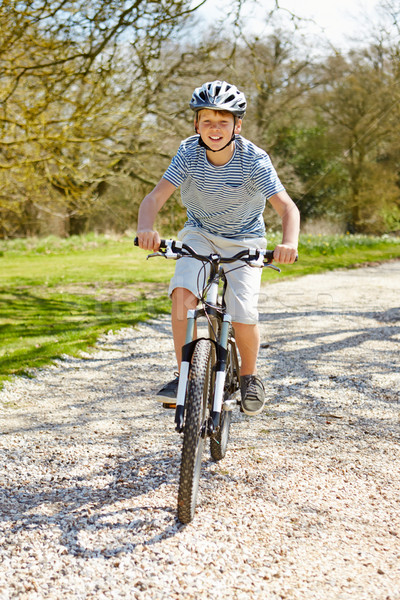 Young Boy Riding Bike Along Country Track Stock photo © monkey_business