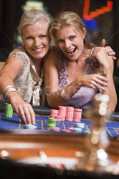 Two women gambling at roulette table Stock photo © monkey_business