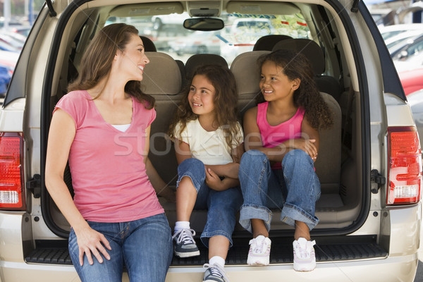 Woman with two young girls sitting in back of van smiling Stock photo © monkey_business