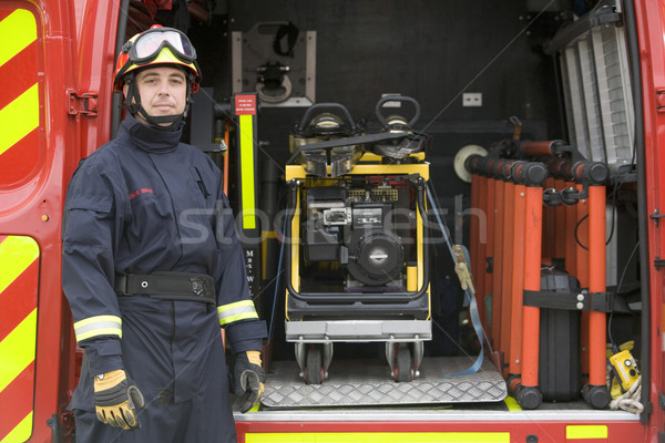 Firefighters standing by the equipment in a small fire engine Stock photo © monkey_business