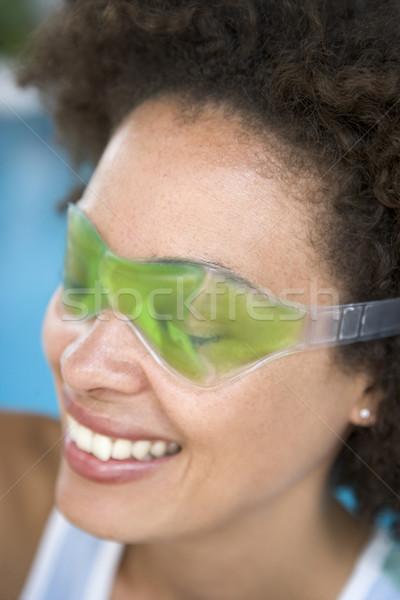 Stock fotó: Nő · ül · szem · maszk · mosolyog · női