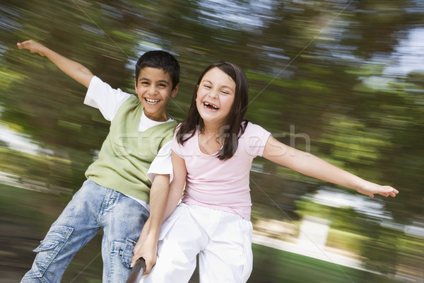 Two children having fun on roundabout Stock photo © monkey_business