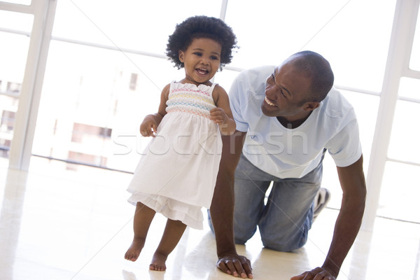Father and daughter indoors playing and smiling Stock photo © monkey_business