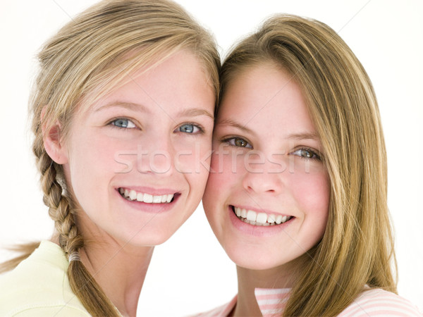 Two girl friends together smiling Stock photo © monkey_business
