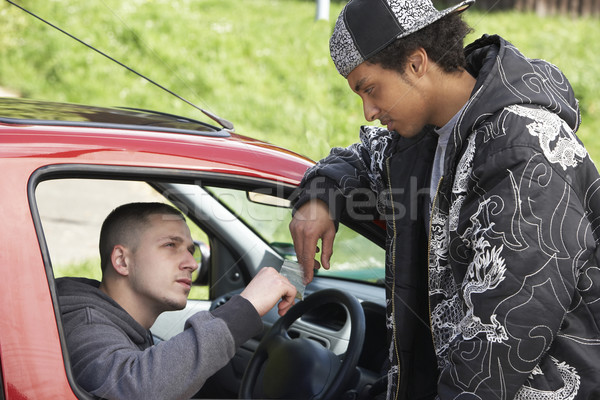 Young Man Dealing Drugs From Car Stock photo © monkey_business