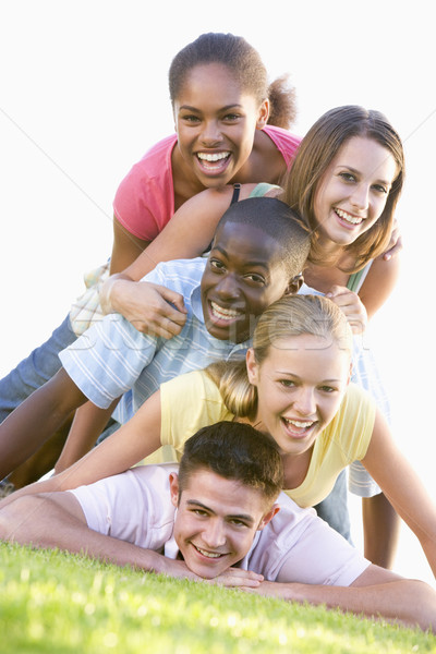 Group Of Teenagers Having Fun Outdoors  Stock photo © monkey_business