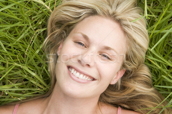 Overhead view of young woman lying on grass Stock photo © monkey_business