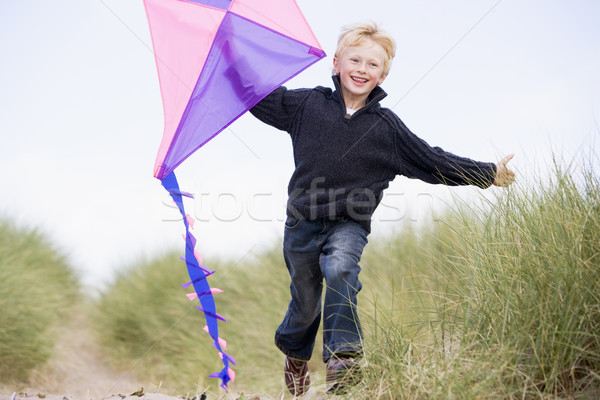 Lopen strand Kite glimlachend kind Stockfoto © monkey_business
