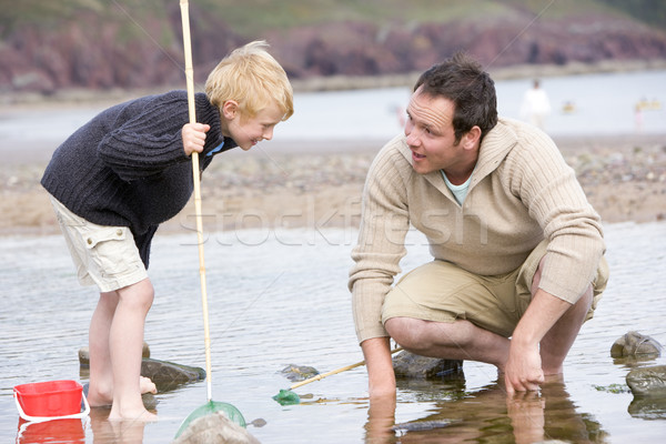 Father and son at beach fishing Stock photo © monkey_business
