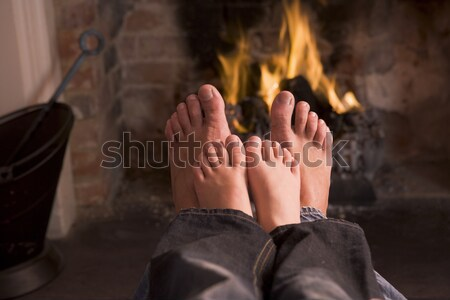 Family of feet warming at a fireplace Stock photo © monkey_business